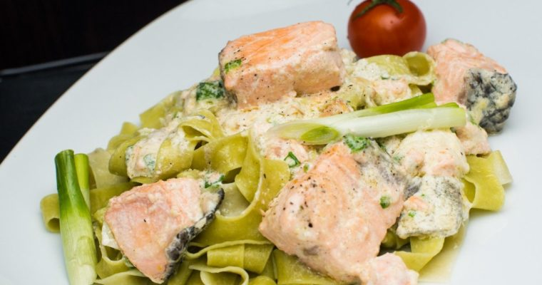 Pasta with salmon in a creamy garlic sauce