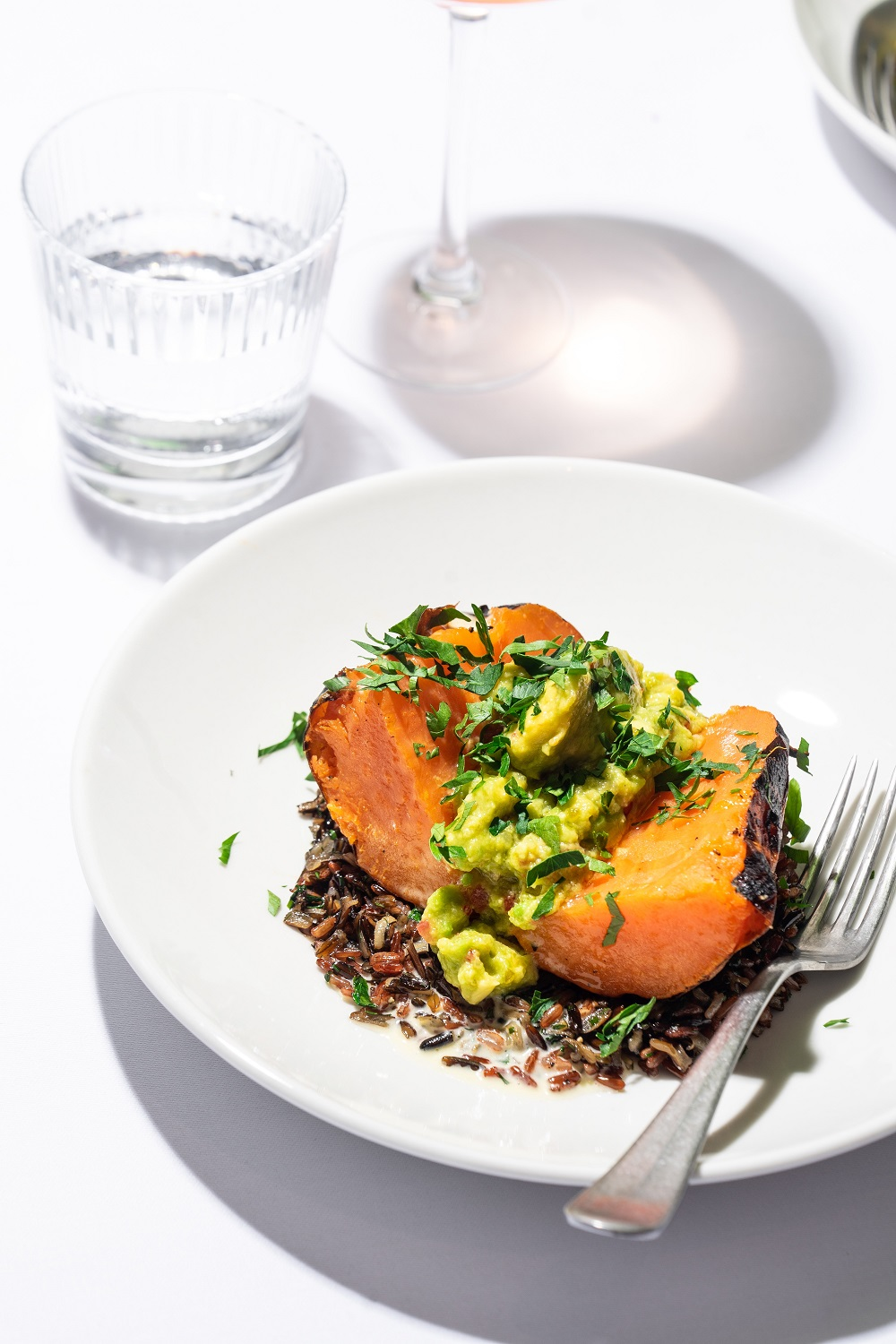 Sweet potatoes with avocado cream and wild rice