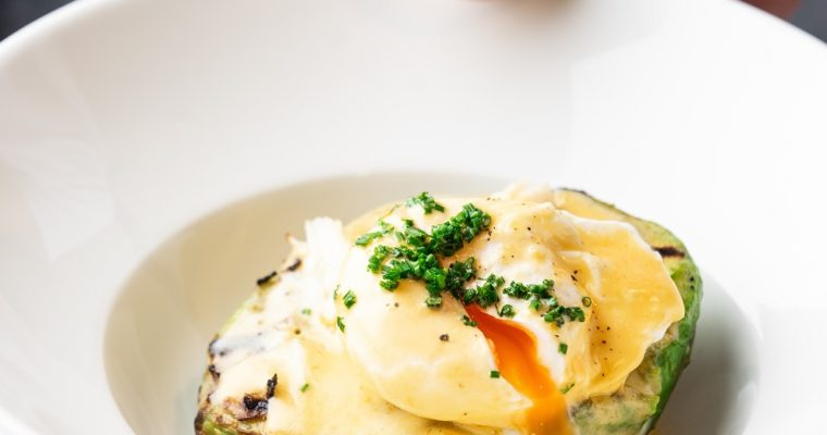 Fried avocado with crab and poached egg