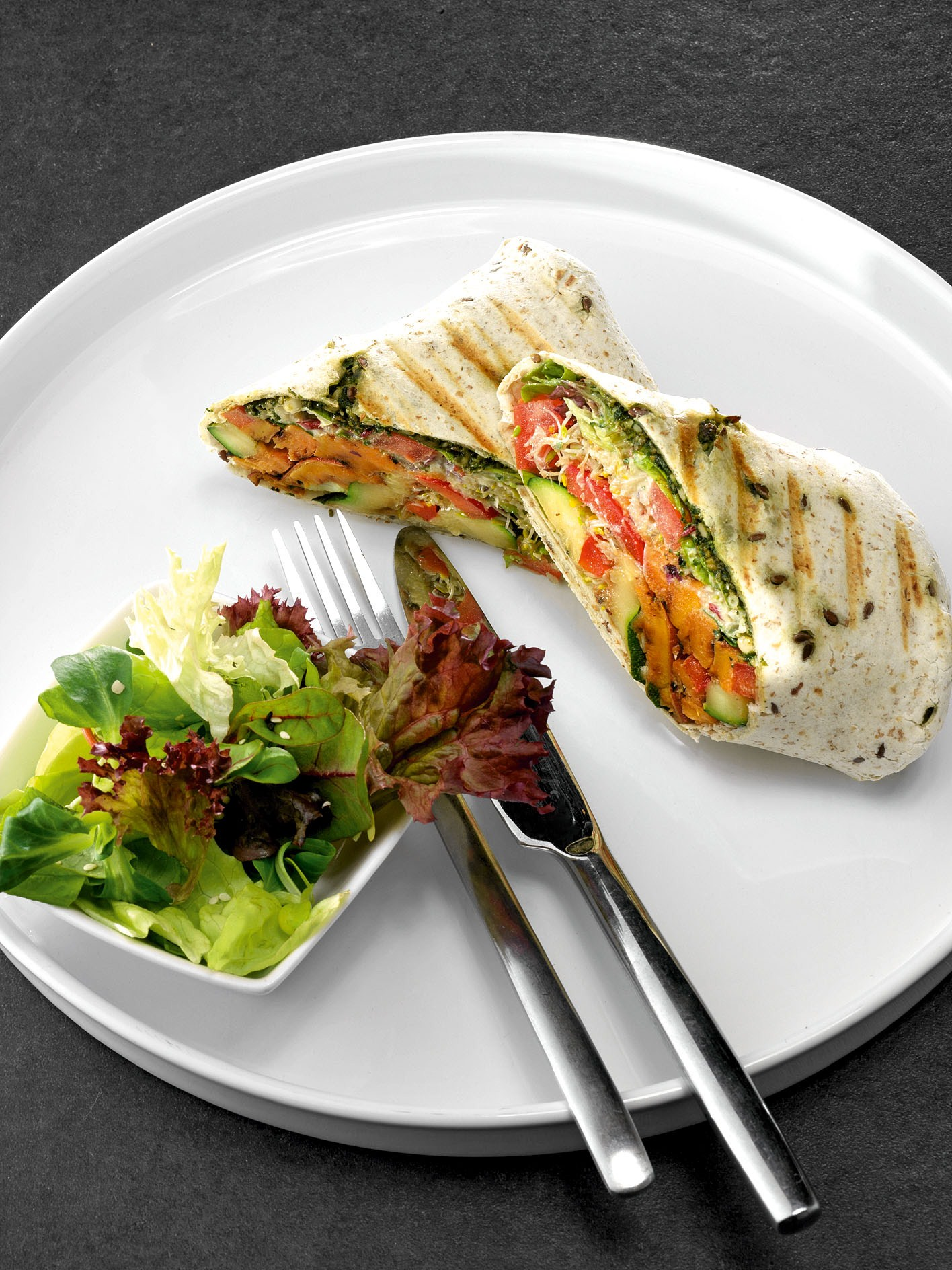 Burrito with grilled vegetables and pesto