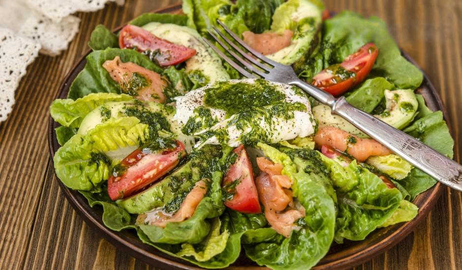 Roman salad with avocado, salted salmon and egg