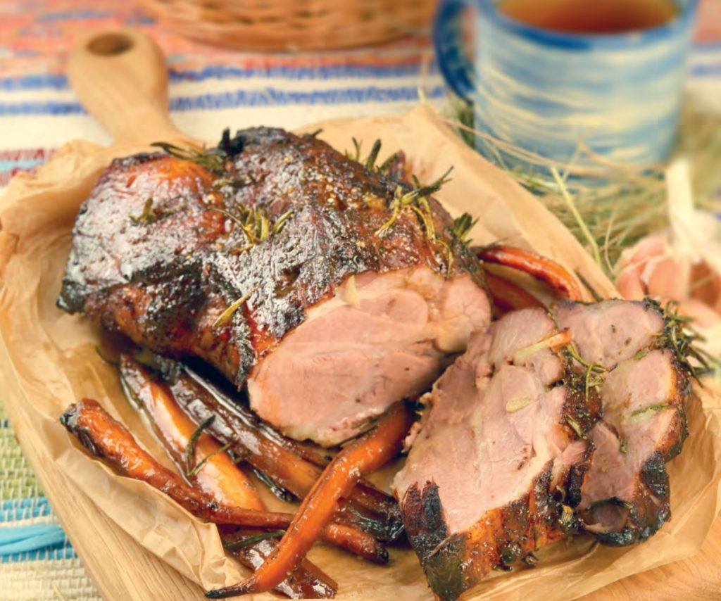 Roasted pork neck with carrots and honey