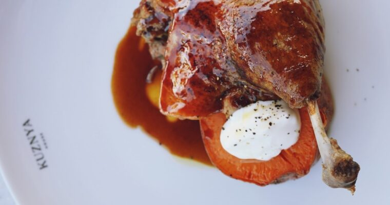 Duck leg confit with baked sweet potato and caponata