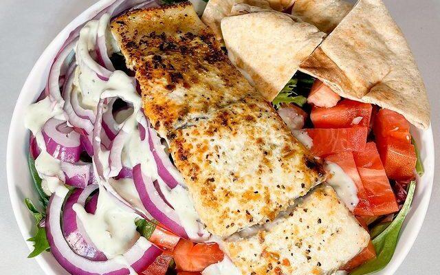 Lemon Pepper Barramundi over a Mediterranean Salad